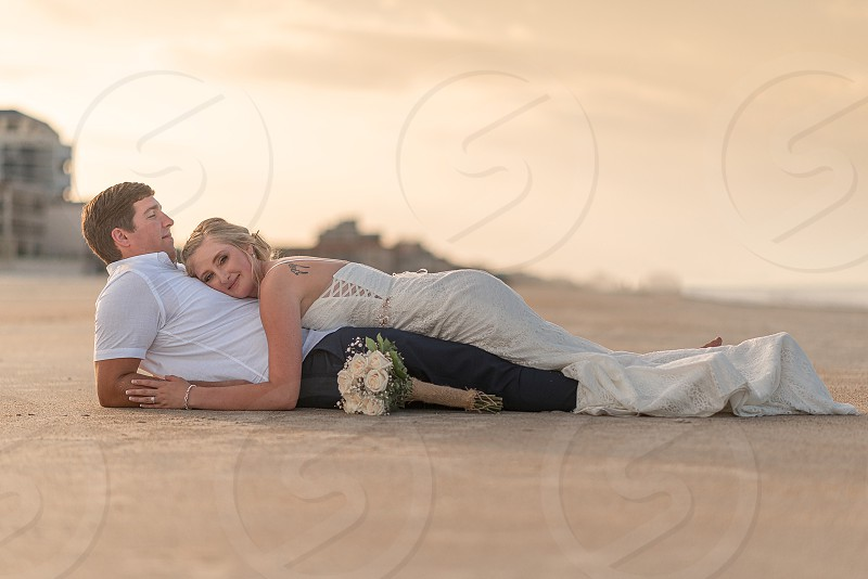 Newlywed couple on a beach in Florida. photo