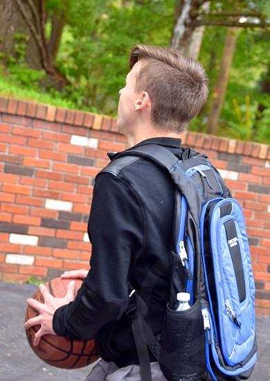 Teen Boy shooting hoops photo