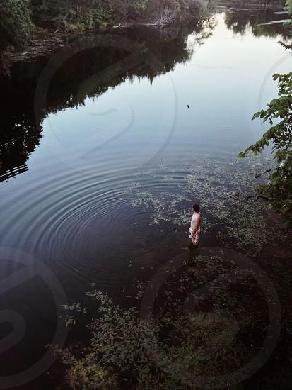 man on swamp photo