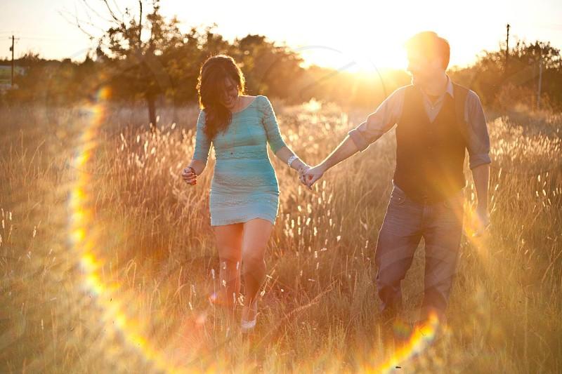 couple walking through field photo