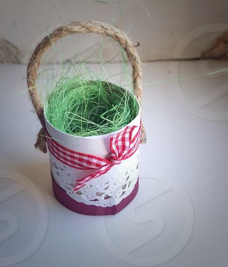 green grass on brown handled white basket photo