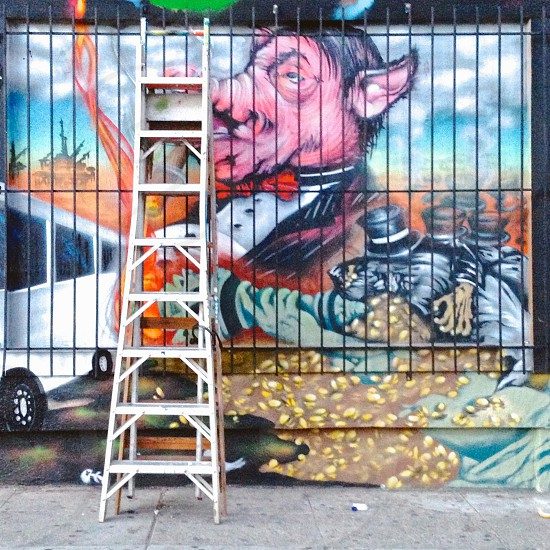 Mural with leaning ladder.  photo