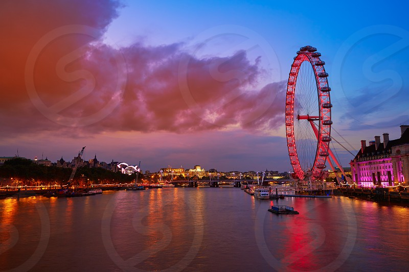 London sunset at Thames river near Big Ben in England photo