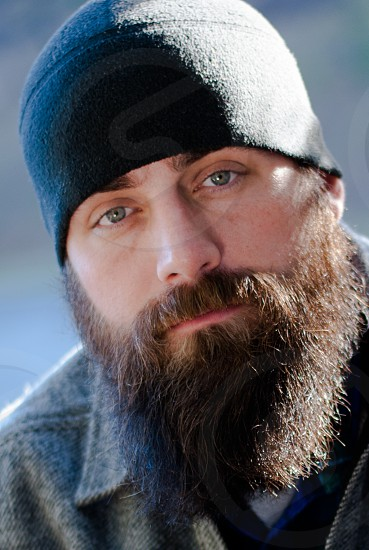 Close up of bearded man with beanie photo
