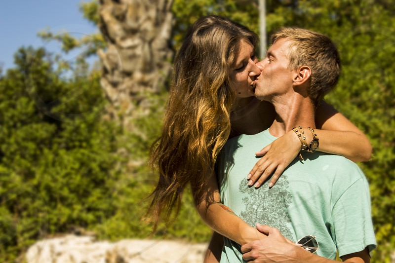 man and woman kissing each other photo
