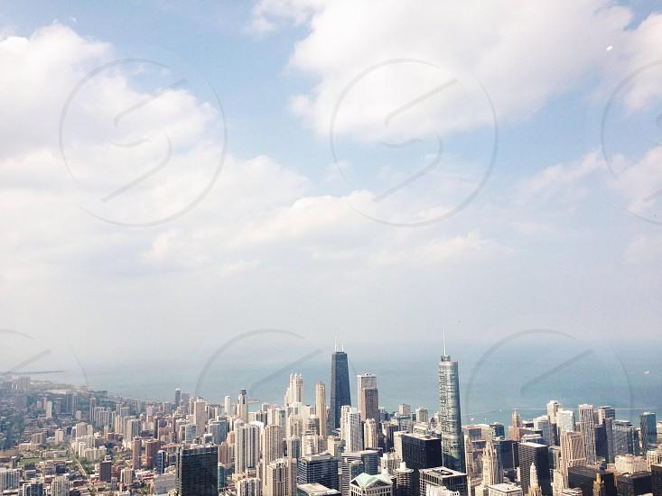cityscape under white clouds photo