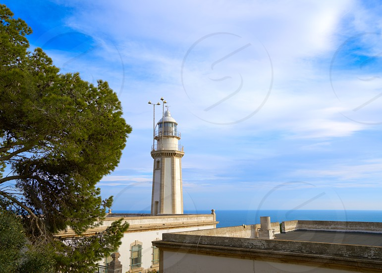 Cap de la Nau Nao cape lighthouse in Xabia Javea Mediterranean sea of Alicante Spain photo