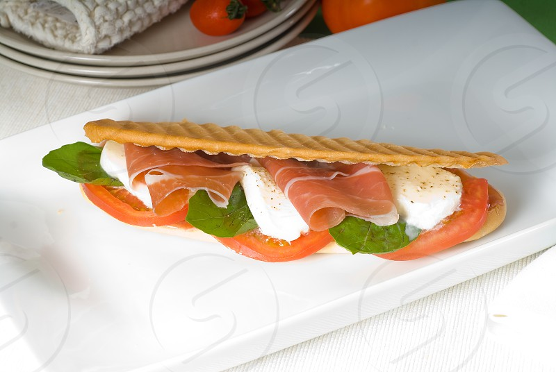 panini sandwich with fresh caprese and parma ham photo
