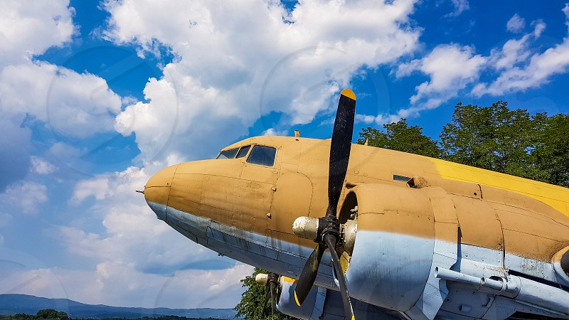 Vintage World War 2 aircraft in army cammo colors. photo