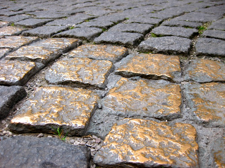 Gold striped pavement outside the Viscardigasse in Munich Germany in memorial of civil resistance to the Nazis and Hitler photo