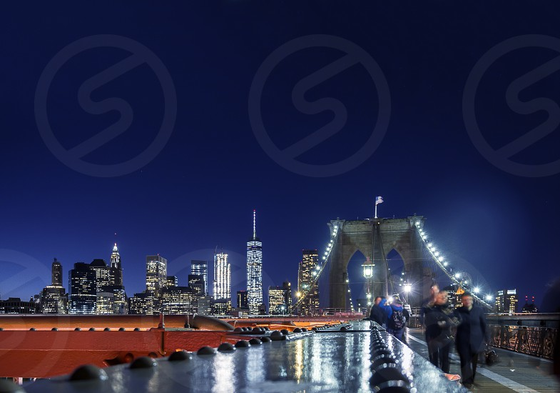 New York night skyline seen from the Brooklyn Bridge pedestrian path photo