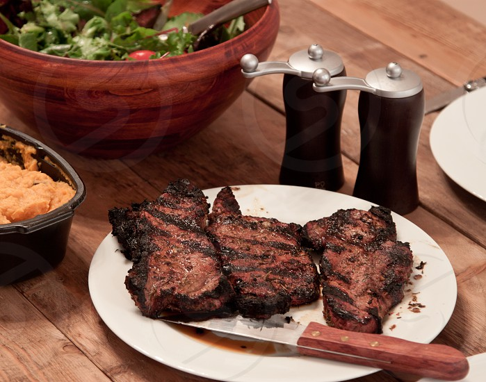 stake dinner hearty wood table relax cozy warm photo