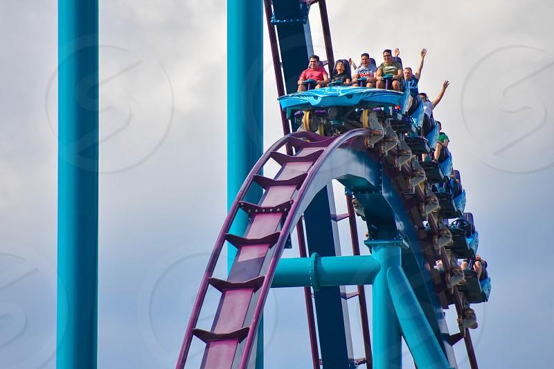 Orlando Florida . February 17  2019. People having fun Mako Rollercoaster on lightblue cloudy sky bakcground at Seaworld   (7) photo