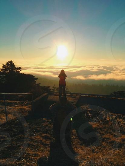 Person watching Sunset photo