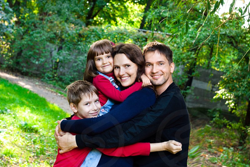 Beautiful family have fun on nature love baby kid mom dad son daughter joy photo feelings warm sweet smile real happy couple  photo