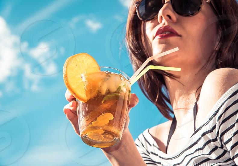 Ice tea Drink cocktail woman girl beverage orange ice blue sky sunglasses photo