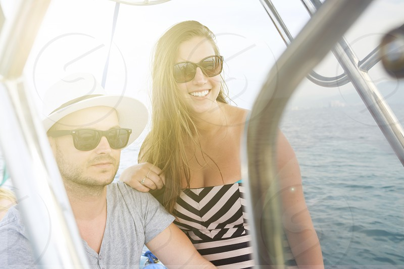 Young man and young woman enjoying a boat ride on vacation. photo