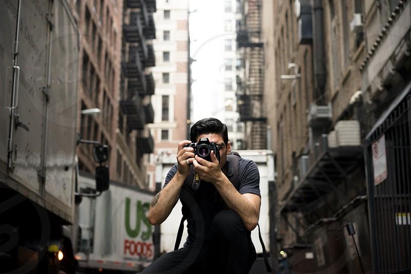 Photographer young guy street Nikon urban explorer street photographer street sale t shirt alley buildings Chicago dark photo