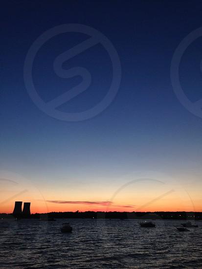 Sunset over water Sky Massachusetts  photo