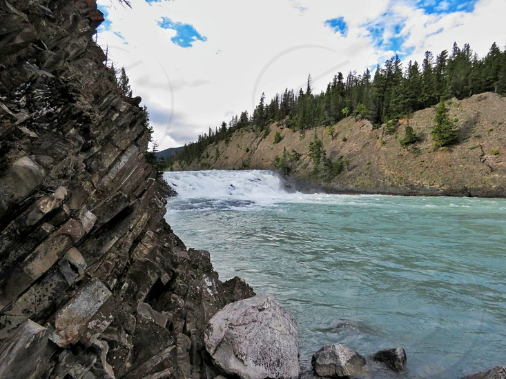 Bow Falls Banff National Park Canada turquoise waters mountains layered rocks blue sky clouds summer landscape nature adventure photo