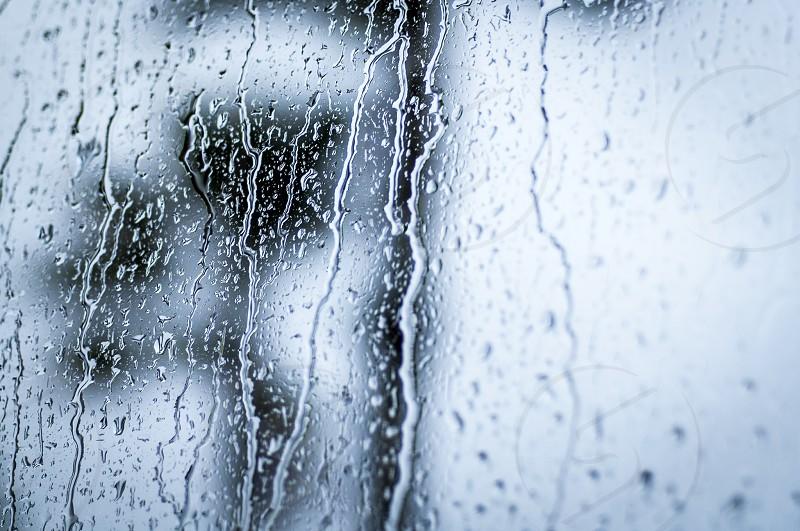 rainy day window rain drops storm thunder water streaks photo