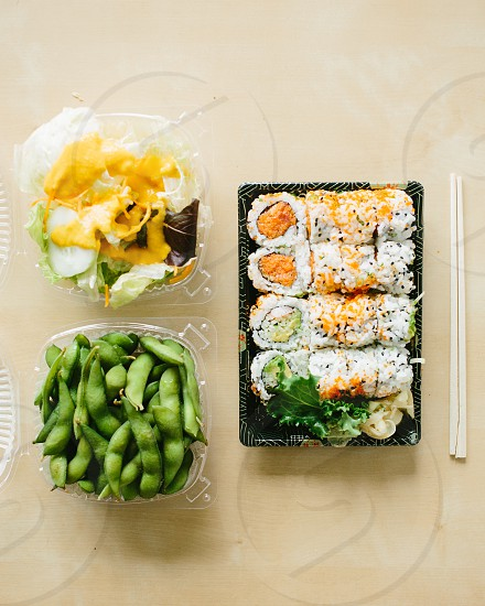 green pea pods and sushi rolls photo