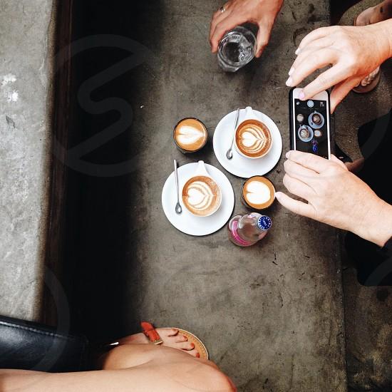 brown cappuccino on mug photo