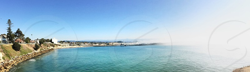 Panorama of the Santa Cruz wharf being swallowed by early morning fog. photo