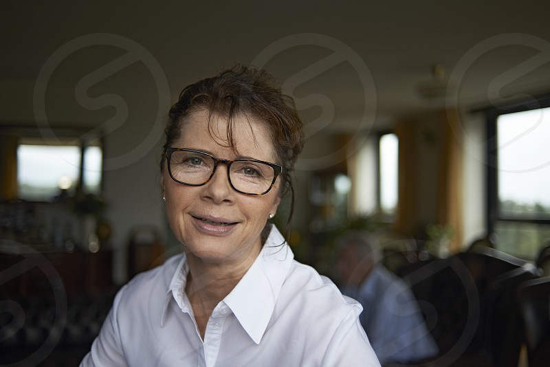 Elderly woman in her home wearing spectacles and smiling photo