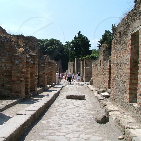 people touring on ancient ruins photo
