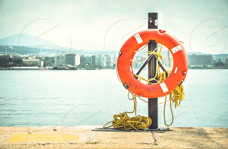 Orange Lifebuoy At Port photo