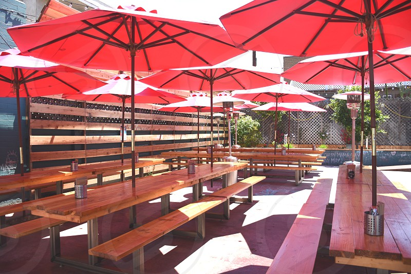 picnic tables under umbrellas during daytime photo