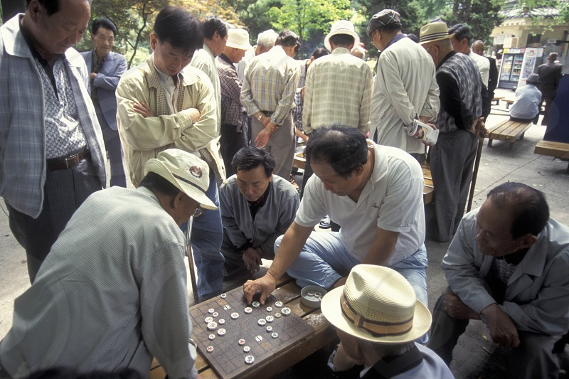 seniors play a board game at the Tapkol Prk in the city of Seoul in South Korea in EastAasia.  Southkorea Seoul May 2006 photo