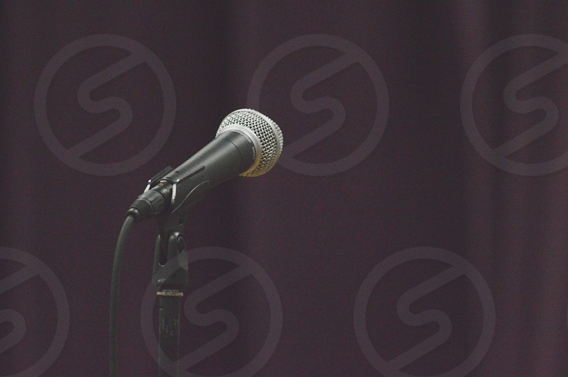 black microphone with stand photo