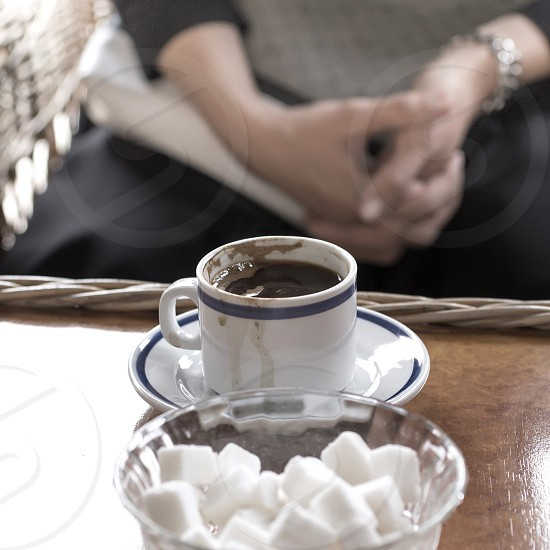 Hot coffee on old wood table with blur background natural light photo