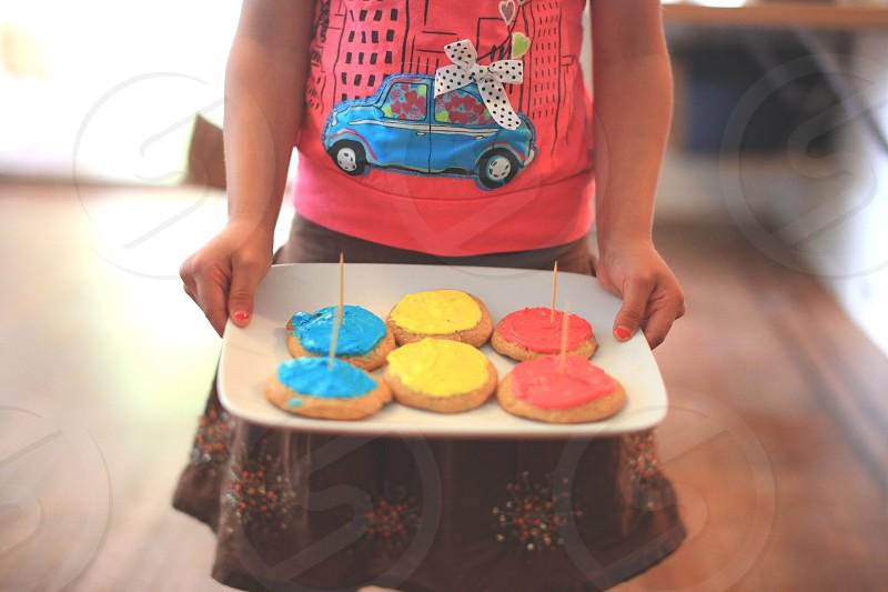 girl holding white ceramic platter photo