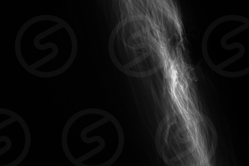 Light painted glowing abstract black and white curved lines on a black background photo