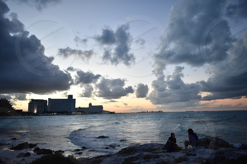 Welcome to cancun a caribbean paradise in mexico a place with wonderful and beautiful places there is nothing like enjoying a sunset on the beach. photo