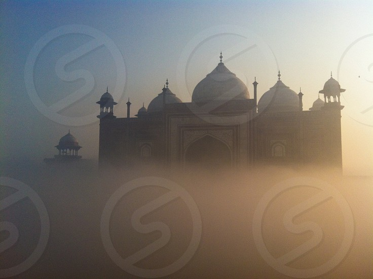 Morning fog created a floating Mosque in Agra India photo