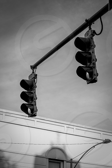 grayscale photo of traffic lights photo