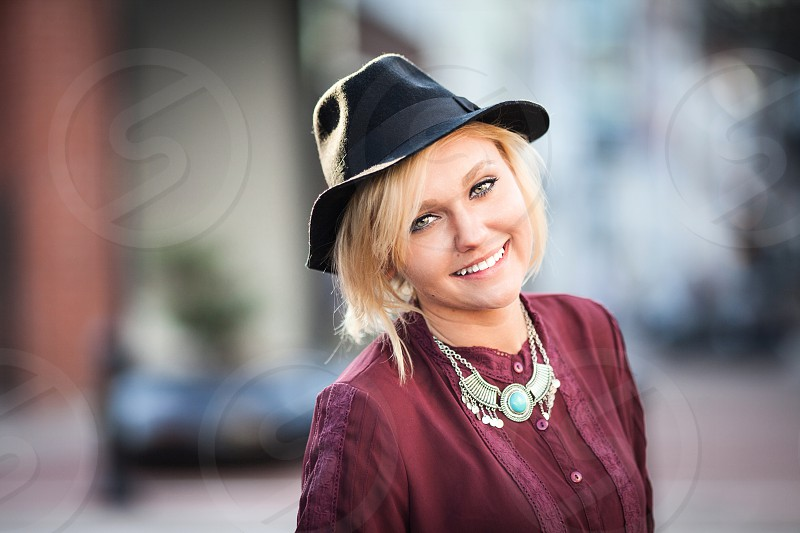 lady wearing black hat photo