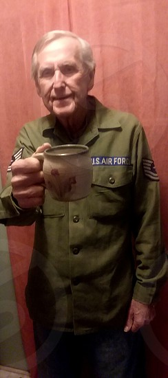 "retired veteran saying "" cheers"" with his coffee photo"