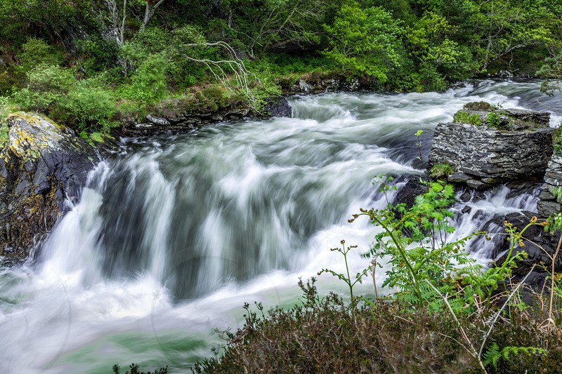 Raging torrent pouring out of Loch Morar photo