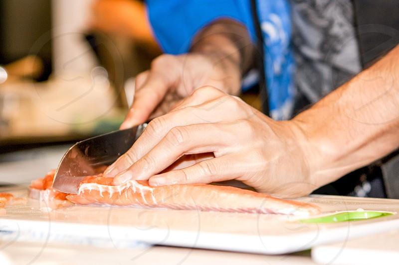 Close up slicing fresh salmon fillet photo