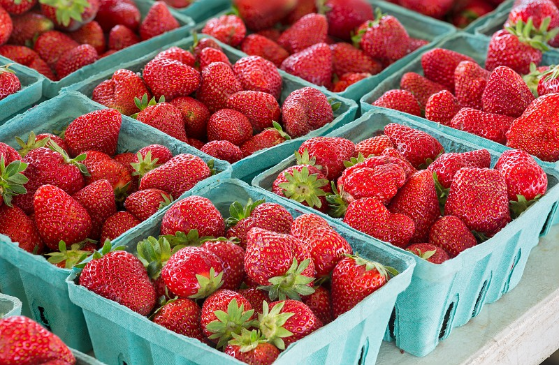 Fresh strawberries for sale at a local farmers market photo