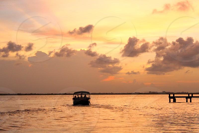 Wanderlust. Lake. Sunset. Boat. Peaceful. photo