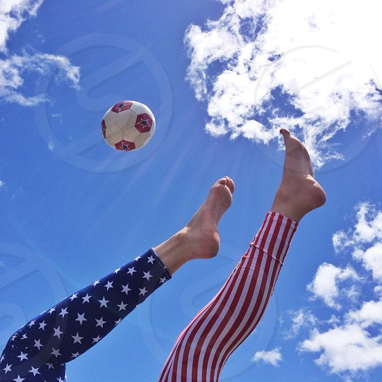 human playing soccer game photo