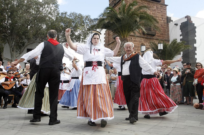 a traditional Dance in the old town of Teguise on the Island of Lanzarote on the Canary Islands of Spain in the Atlantic Ocean. on the Island of Lanzarote on the Canary Islands of Spain in the Atlantic Ocean. photo