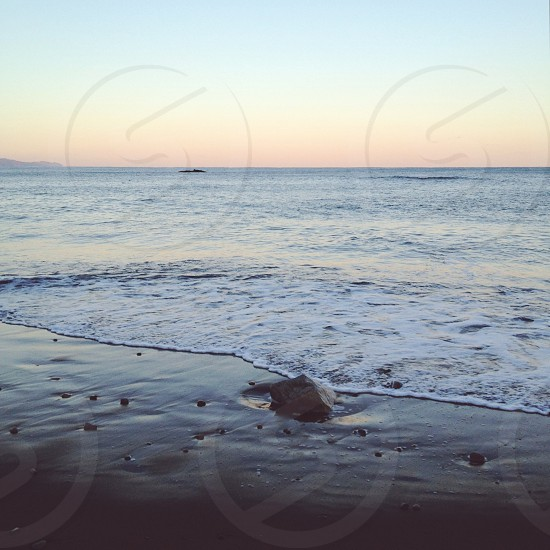 gray sand beach photo