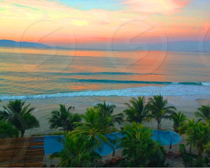 tropical beach at sunrise photo